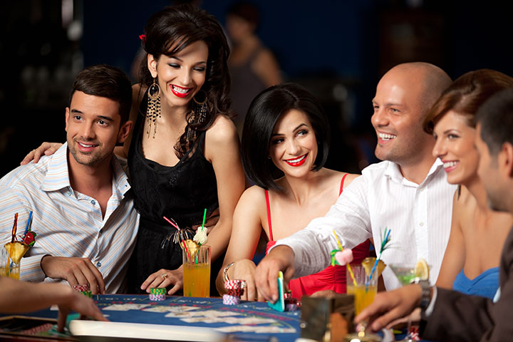 photo on group having fun on casino tables